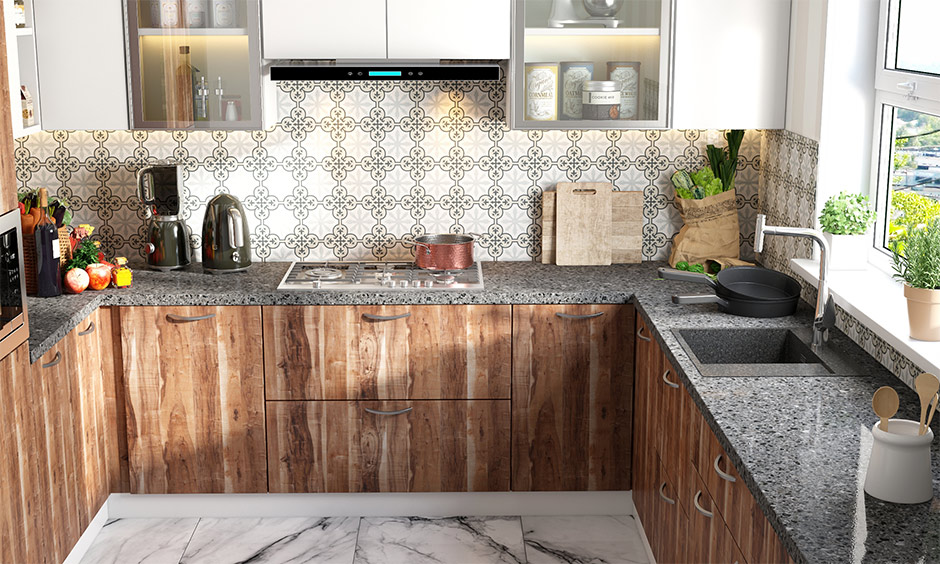 Grey quartz kitchen sinks and a grey granite slab in this kitchen with wooden cabinets look rustic.