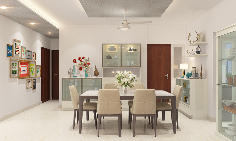 2bhk interior design cost of the dining room with a six-seater dining table and box cabinets depends on the square feet.