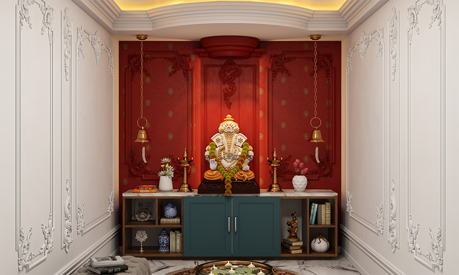 Pooja room pop design with more detailed reliefs on the wall enhances the layout of pooja room.