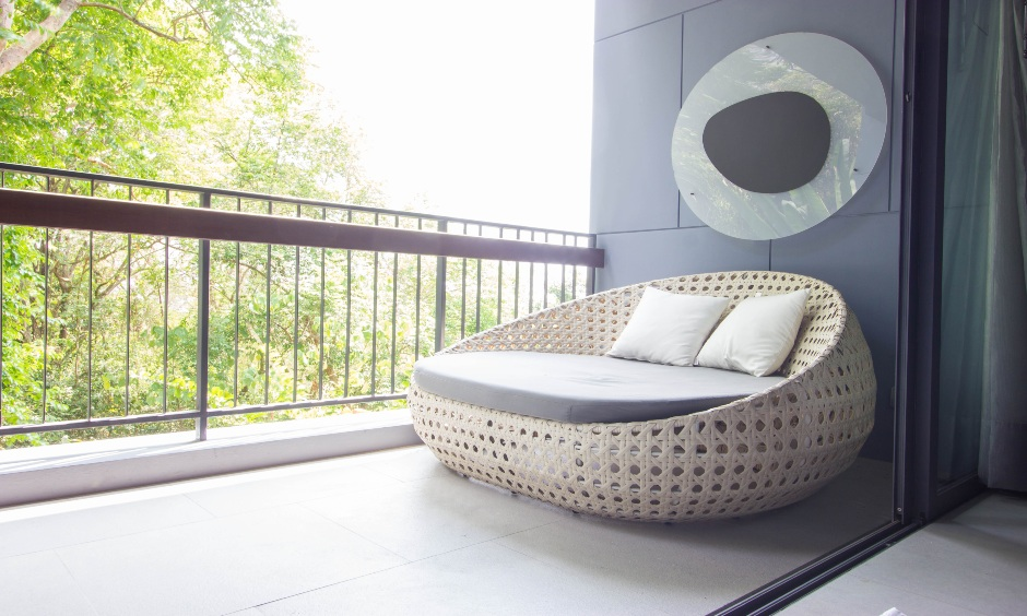 Balcony grey wall with a bold piece of decor in a minimal and classy design is the balcony sidewall design.