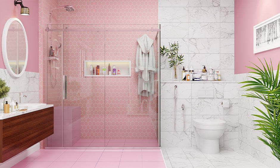 Girls bathroom with geometric shaped tiles with a white and pink theme