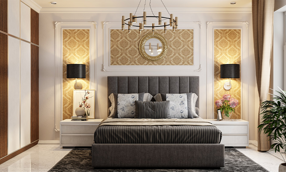 Pop design for master bedroom, POP wall moulding & gold wallpaper lends a classy look to the area.
