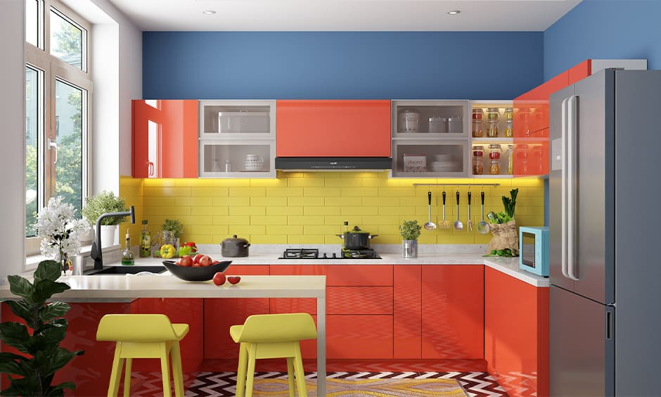 Kitchen with a red-and-yellow theme and glass shutter cabinets