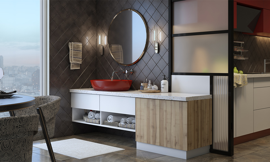 Bold red washbasin cabinet design for dining room against the grey pattern wall looks stunning.