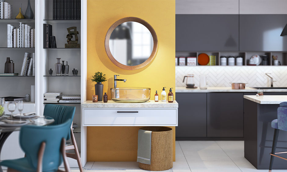 Classy glass washbasin design in dining room rests on a white marble top against a yellow background simplistic yet stylish.