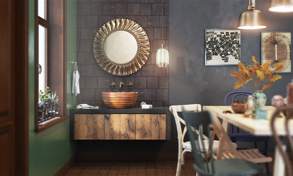 Modern dining hall washbasin made from wood on a pitch-black quartz countertop with large copper mirror looks elegant.