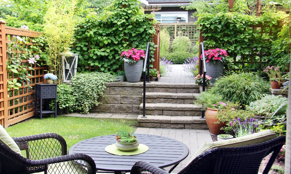 Zen garden design with earthy stones and antique corner shelves and chairs is the simple terrace garden ideas.