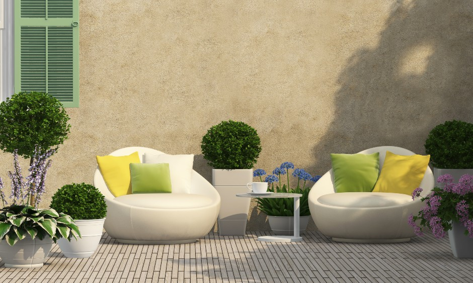 Small terrace garden ideas, moveable lounge chairs and planters around a nook creates a stunning terrace garden design.