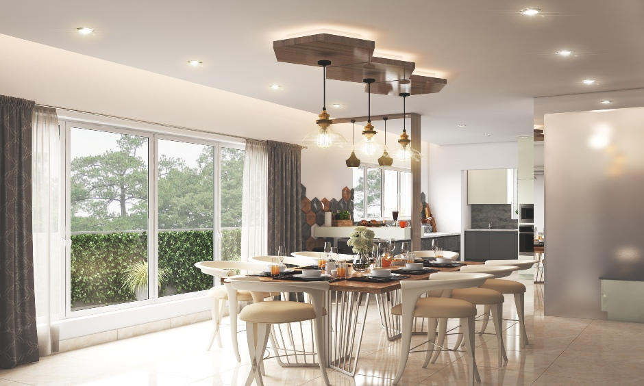 Kitchen cum dining hall ceiling design with unique hanging lights add a befitting sheen to your dining hall.