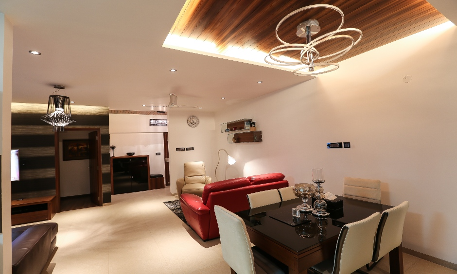 Living room cum dining hall false ceiling design with lights is the latest design and grants a majestic look.