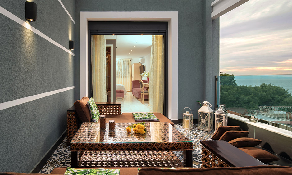 Moroccan floor tiles design for balcony infuse charm and character to space with minimal furniture.