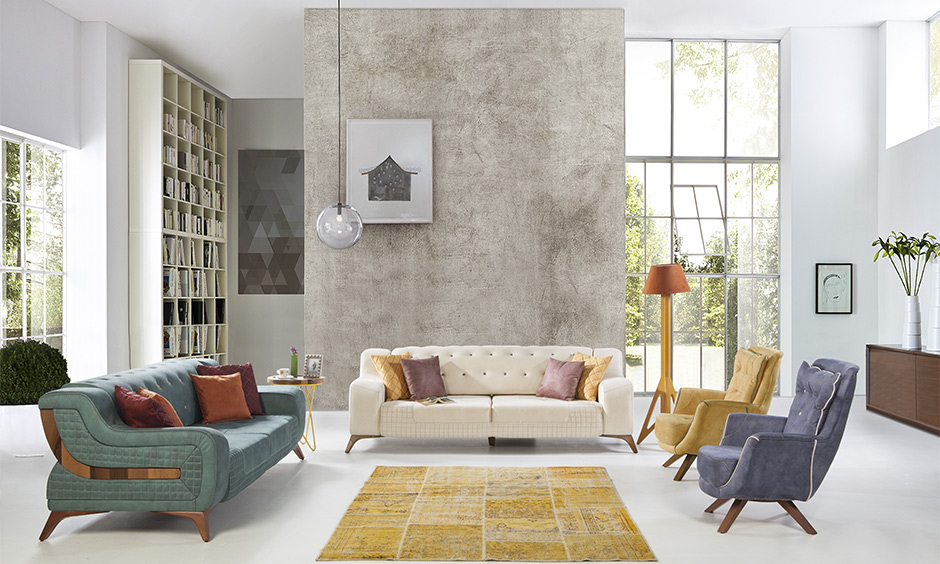 Drawing room wall decoration in a minimal way with the chic hanging lamp and light colours wall adds a softer touch.