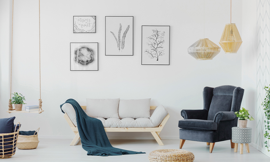 Hanging lamps, the cute swing shelf, and the wall frames bring charming to space is the small drawing room decoration ideas.