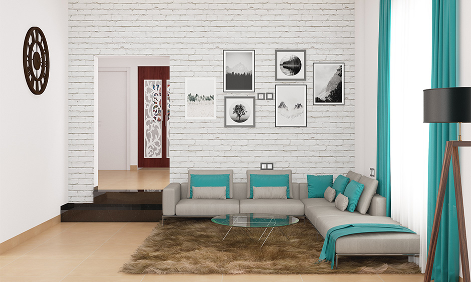 Minimal drawing room decoration with a colour scheme, the rug and the wall artsy looks bright and welcoming.