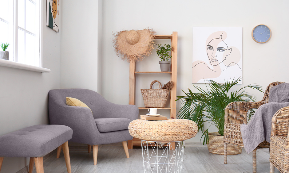 Simple drawing room decoration with different seating options, indoor plants and painting on the wall adds a modern appeal.