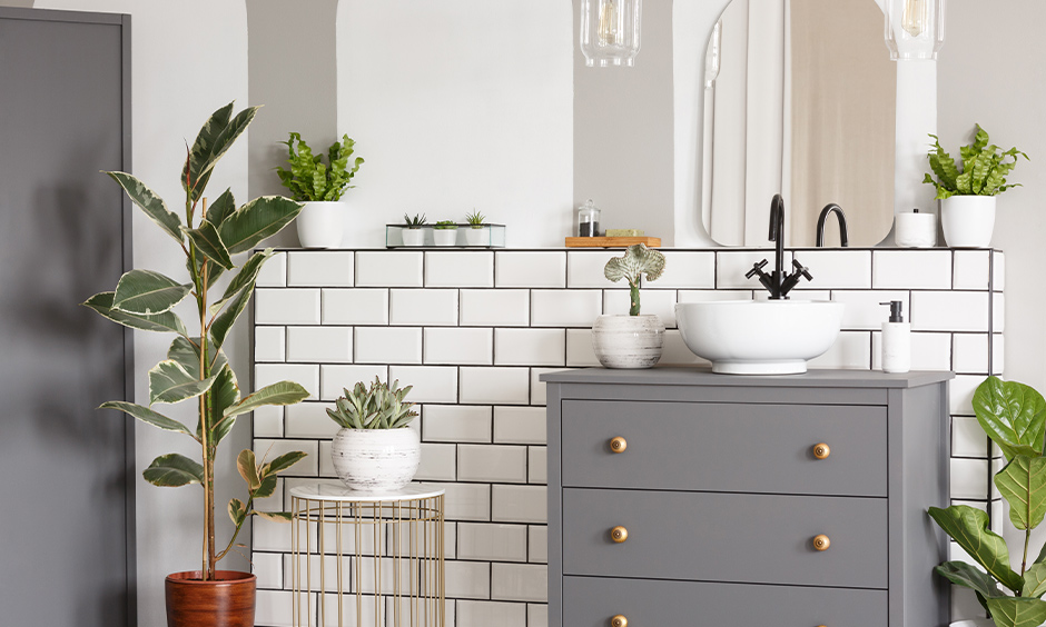 Custom-made vintage hardware adds more character to the space that is how to decorate a tiny bathroom.