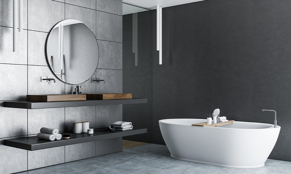 How to decorate a dark bathroom, instead of painting go for tiles and place statement mirrors to make a wall more iconic.