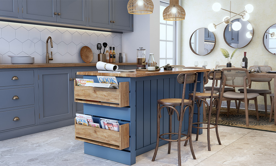 DIY custom kitchen island with built-in magazine holder made of wood and painted in a beautiful airforce blue.