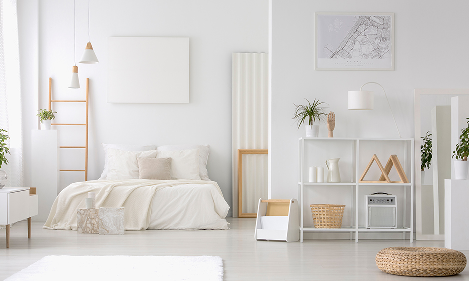 All-white bedroom corner shelf idea, minimal shelf made from wood and painted in white brings elegant to space.