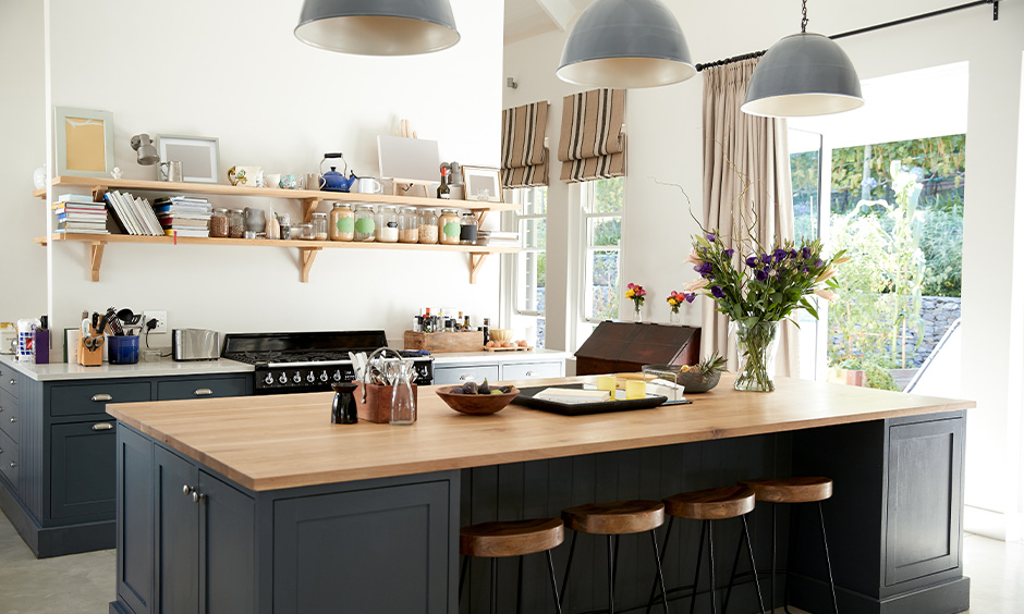 Two hanging open kitchen shelves made from timber to keep your books and jars in the kitchen island looks aesthetic.