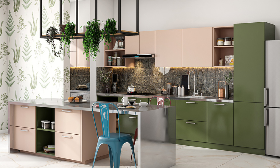 Countertop stainless steel kitchen island in an olive-green-and-pink-themed with backsplash in grey brings aesthetic.