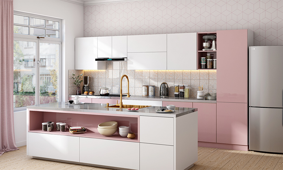 Stainless steel kitchen island table in pink-theme, white-tiled backsplash beautifully blends with the kitchen.