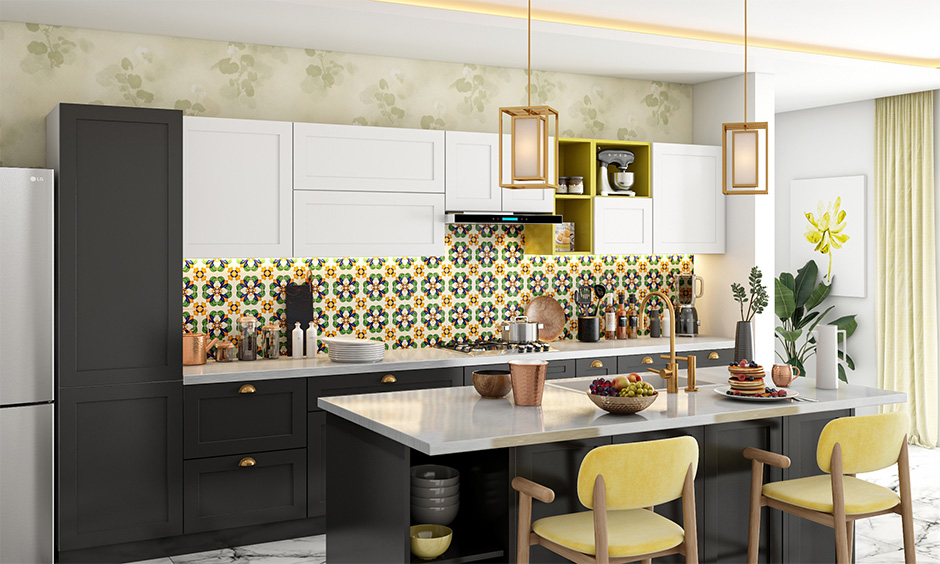 Stainless steel kitchen island with seating, backsplash with dado tiles and cabinets make this kitchen stand out.