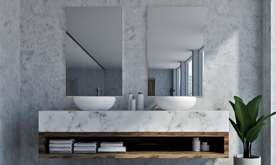 White cultured marble bathroom countertop sitting on an open wooden-framed shelf looks stunning in the minimal bathroom.