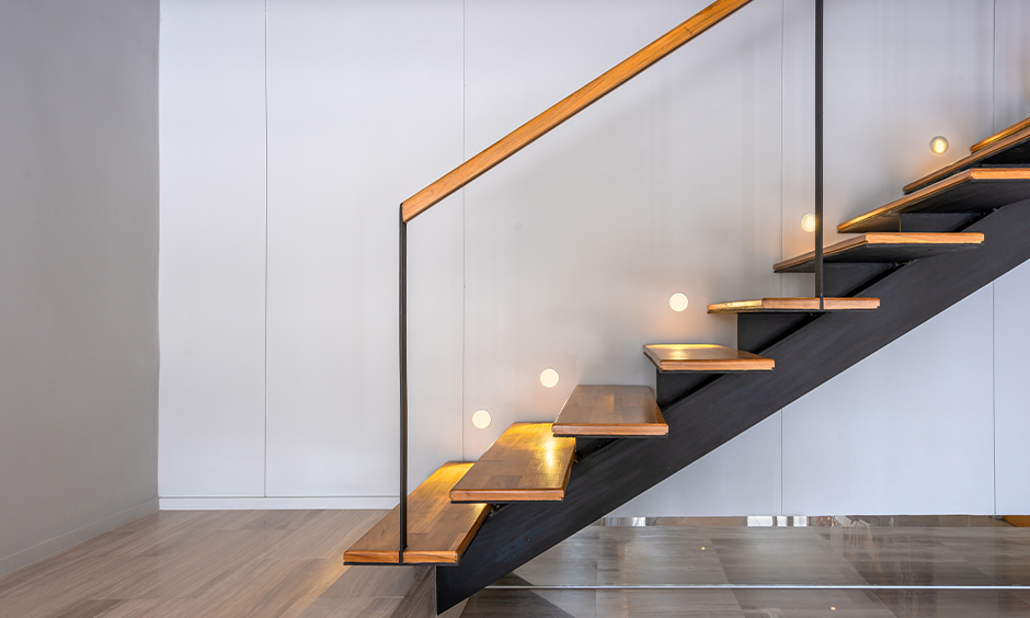 Wooden staircase with inlaid LED lights fitted into the wall embellishes a modern home is the staircase lighting ideas.