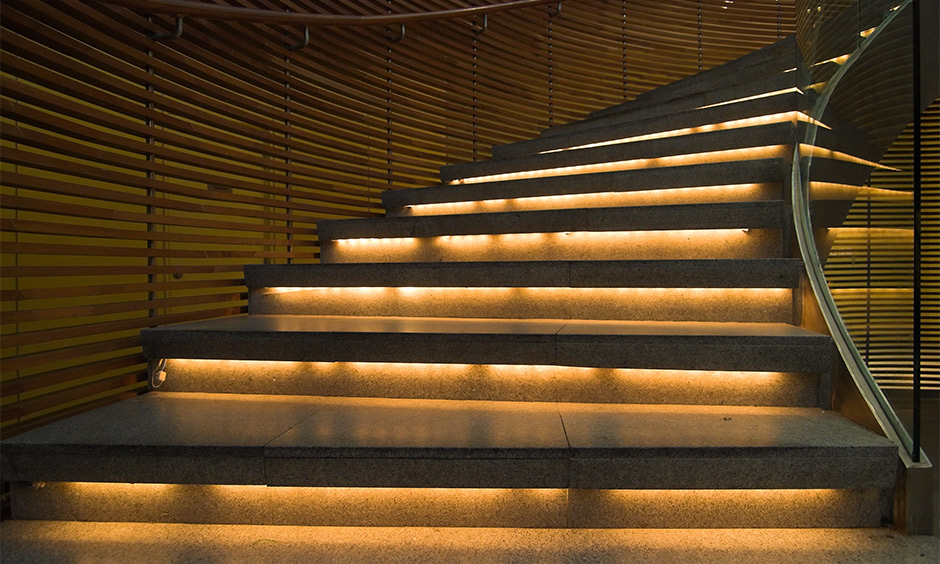 Contour modern staircase lighting designed with LED strips under stair look incredibly chic.