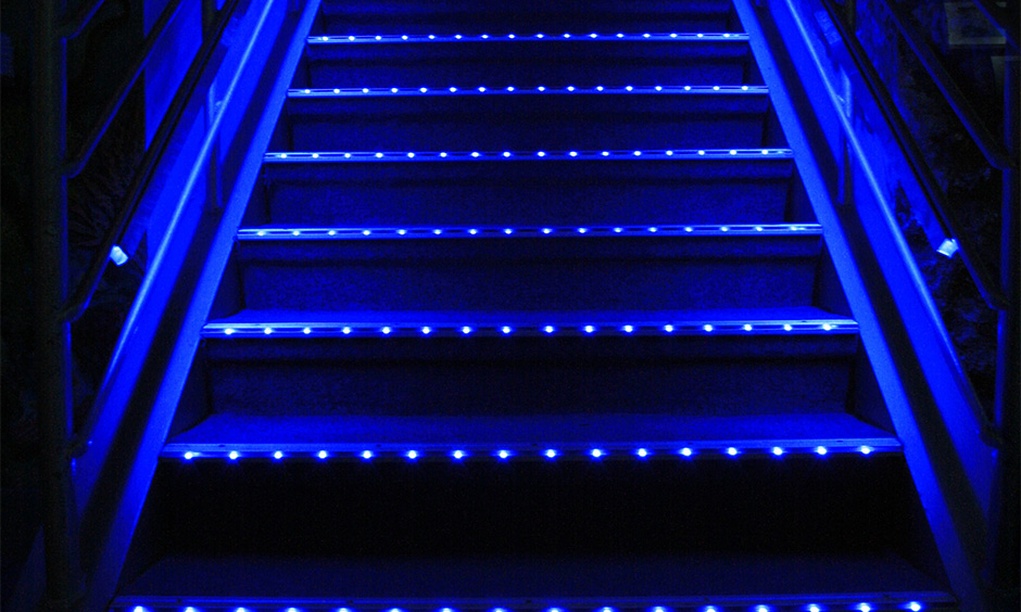 Staircase with tiny blue neon light strips adds an element of fun to space is led lights for staircases idea.