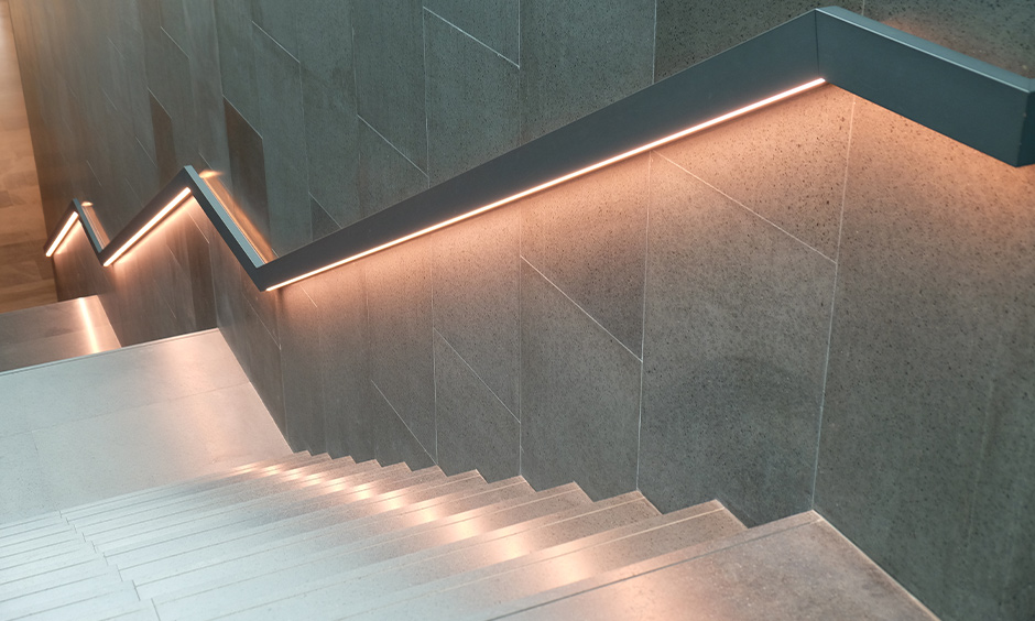 Staircase wall light designed under the railing with led strip transforms home into an abode of calm and serenity.