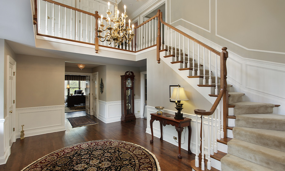 Hanging lights for staircase, gold chandelier adds a unique piece of art to create a sense of intimate luxury.