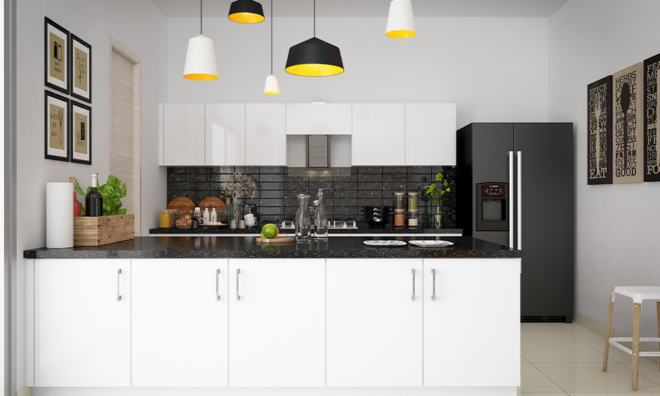 One wall small open kitchen design with the living room in white colour is clean and looks organised.