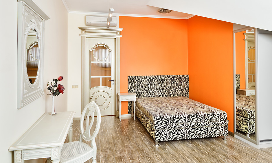 Orange and white wall light colour combination for small bedroom