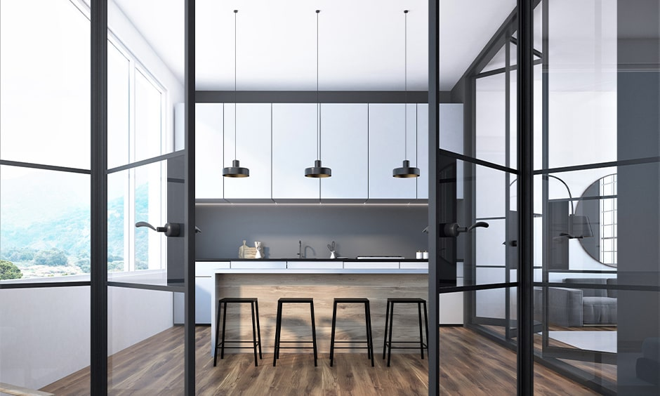 Black-framed bi-fold kitchen door with kitchen glass door