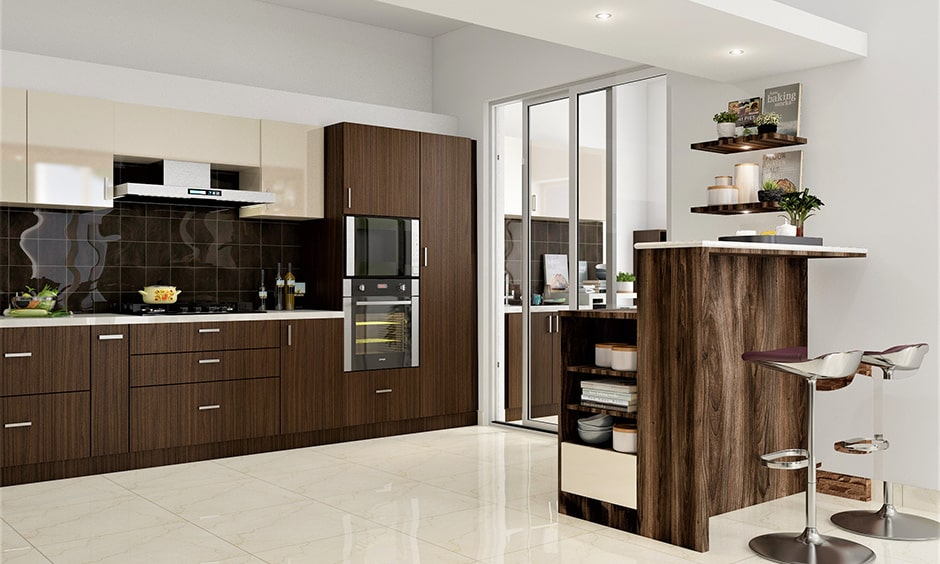 Sliding kitchen doors with glass gives space in this modular kitchen