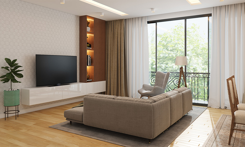 An L-shaped sofa in a small tv room furniture arrangement is perfect for being the centre of activities in the house.