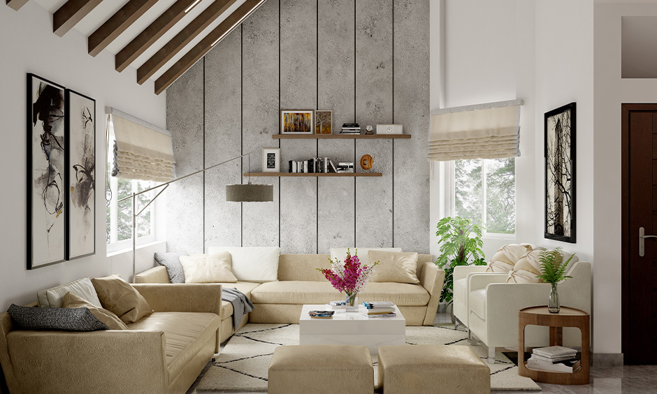 An off-white sofa arrangement in a small living room with two armchairs perfectly placed for easy movement.
