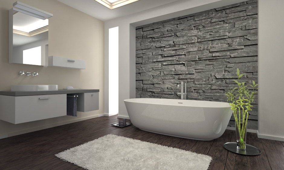 Minimalistic modern bathroom with an artificial stone wall cladding elevates the look of the space.