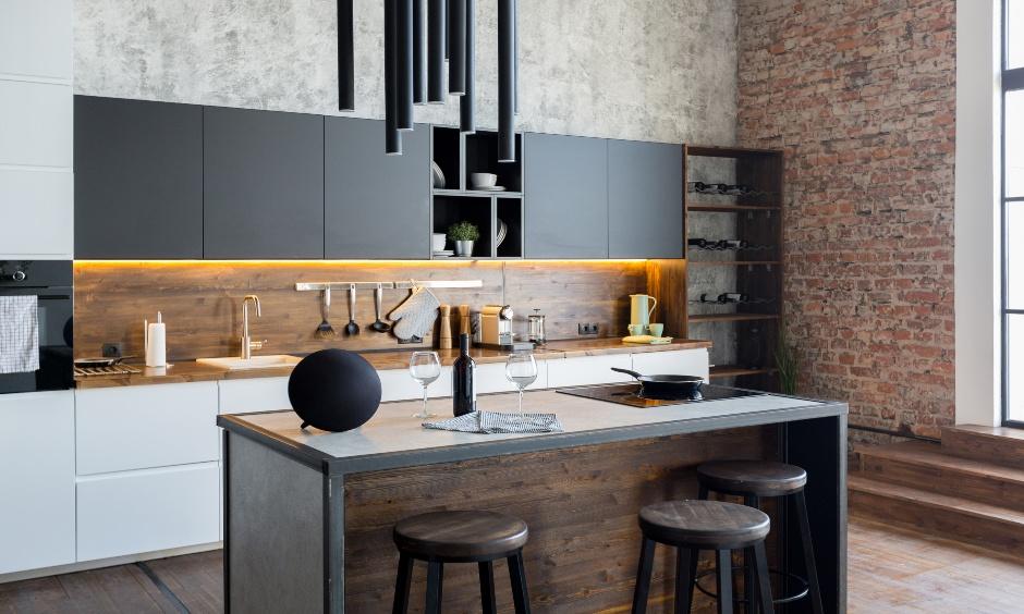 Modern island kitchen with redbrick stone wall cladding looks urbane.