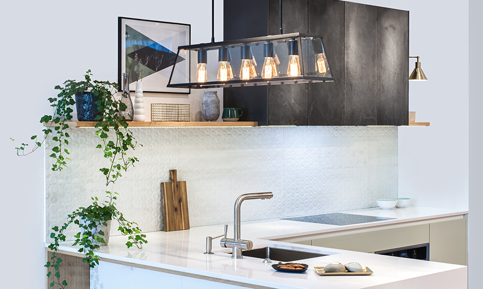 Hanging pendant light over kitchen sink with exposed bulbs look sleek and trendy