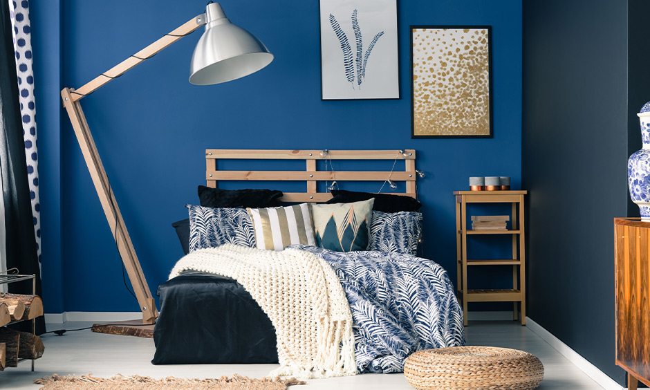 Bedroom wall coloured in a royal shade of blue look energetic, an idea for wall painting bedroom.