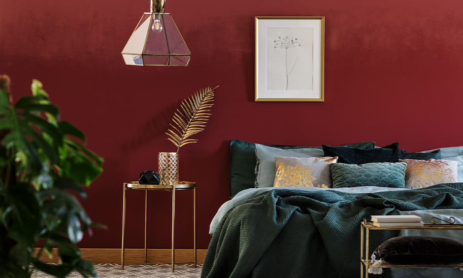 Bedroom wall coloured in red with beautiful look, wall paint design idea for the bedroom.