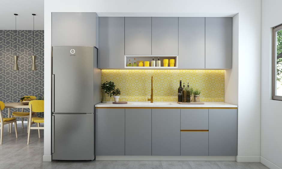 Modular kitchen with patterned tiled backsplash in yellow and white