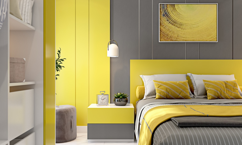 Latest bedroom interiors design with headboard in yellow and sidetable for storage