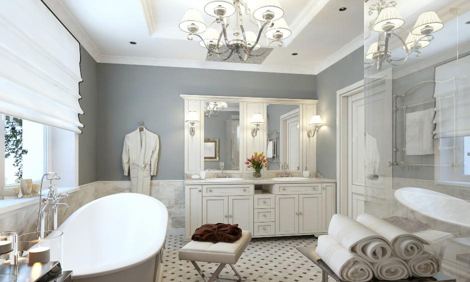 Luxurious bathroom false ceiling in a simple POP design with chandelier looks elegant.