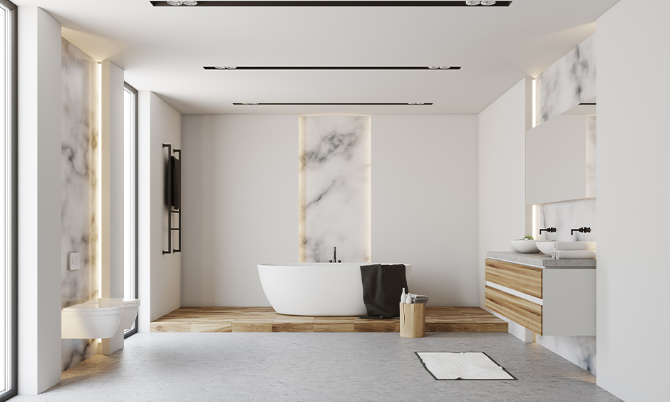 Luxurious bathroom false ceiling designed with cove lights look clean and functional.