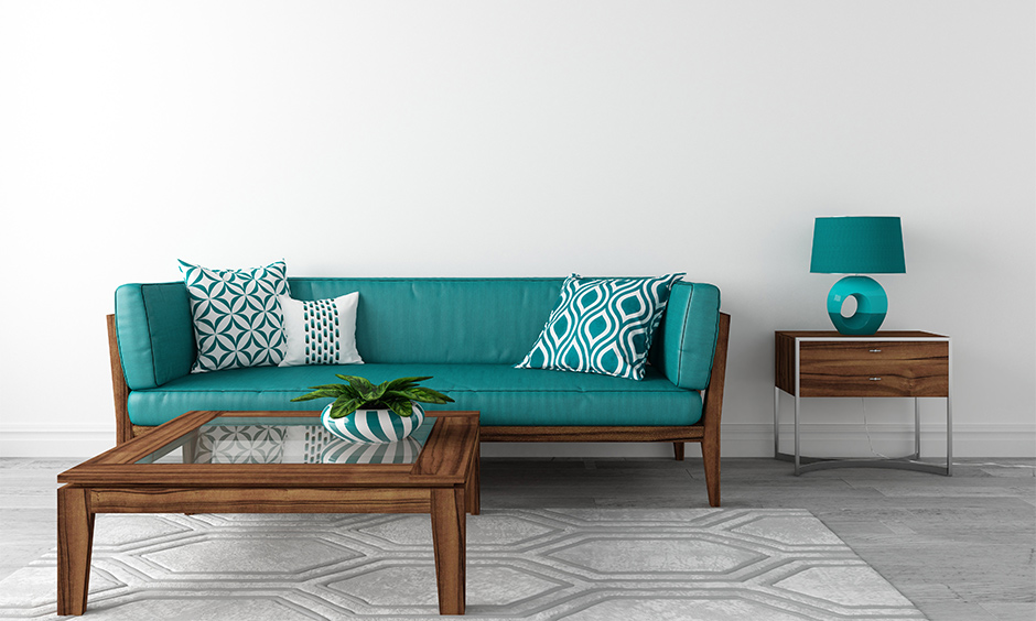 Living room decorated with aqua blue sofa and lamp to bring coolness to the area, aqua paint colour for living room.