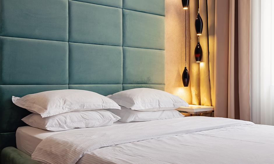 Aqua blue headboard colour in master bedroom enhances the soothing vibes, aqua color best paint.